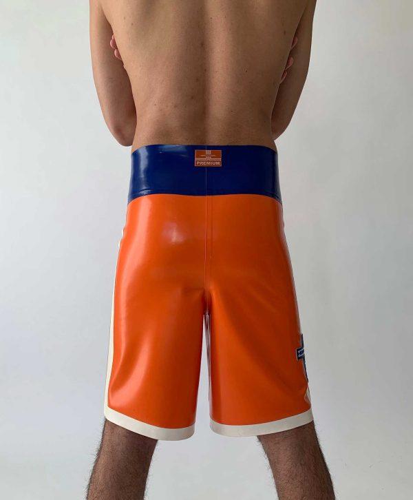 Latex Boxer Hose in orange, super weit geschnitten am Bein, mit hohem Bund, weißen Streifen und blauen Logos, Premium Kollektion