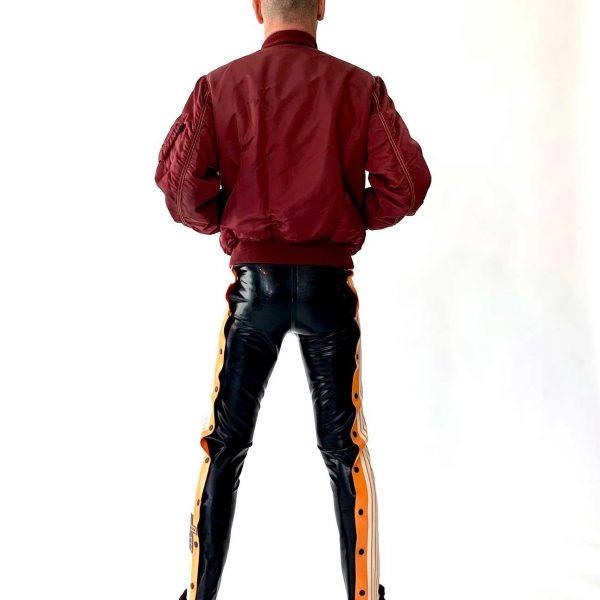 Latex Schnellficker Hose in lang, schwarz mit orangen Applikationen und weißen Streifen, Premium Kollektion
